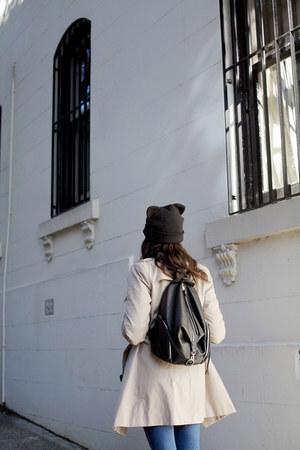 beige trench coat Target coat - navy high-waisted Wrangler jeans