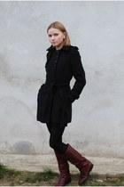 black coat - maroon boots