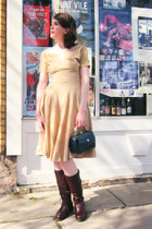 dark brown miz mooz boots - tan dress - navy 1950s vintage bag