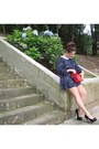 Red-bag-navy-dress-white-necklace