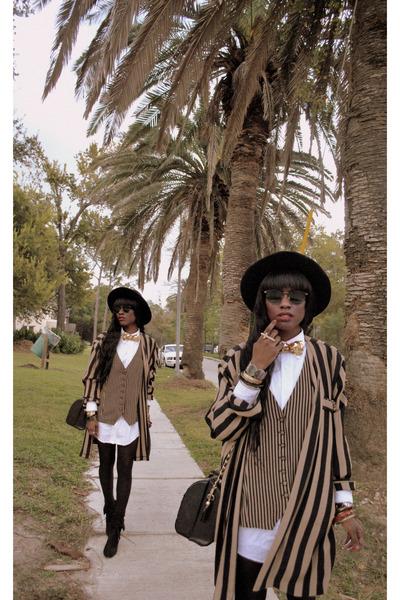 light brown blazer - white blouse - gold tie - black bag - black hat - gold acce