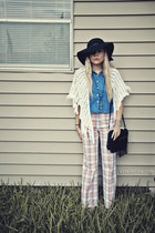 black hat - black purse - off white cape - sky blue blouse