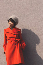 carrot orange coat - eggshell beret hat - black polka dots blouse