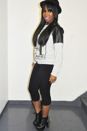 black boots - black sweater - black leggings