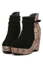 Serpentine Paneled Wedge Boots