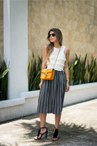 light orange cross body Gucci bag - black midi Jcrew skirt