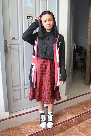 black chiffon Logo shirt - white socks - red midi skirt - black studded sneakers