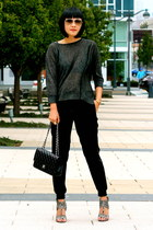 gladiator Nine West shoes - black Chanel bag - black jogging vince pants
