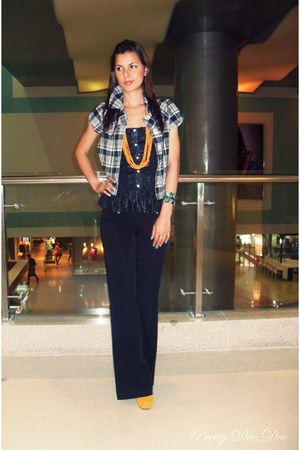 light orange shoes - black strapless top - black flared pants - orange necklace