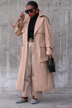 black sweater - Check pattern shoes - Camel coat - black bag - tan pants