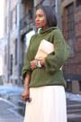 Olive-green-sweater-beige-bag-black-sunglasses-off-white-tulle-skirt