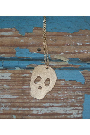 brass skull reborn necklace