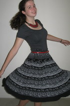 black skirt - charcoal gray shirt - ruby red necklace