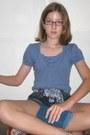 Violet-random-brand-shirt-navy-random-brand-shorts