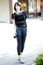 black jeans - black top - gold accessories