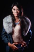 teal fur coat - ivory brocade top - sky blue chain adam & eve necklace