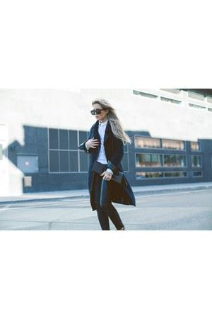 long car coat coat - black clutch bag - wayfarer sunglasses