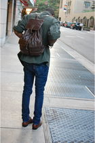 blue Levis jeans - green army jacket - brown Rossetti bag - brown shoes