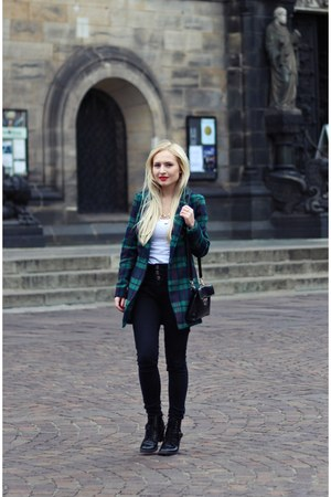 black boots - green blazer - black bag - black pants