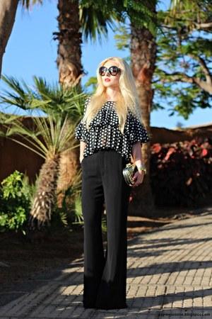 black Prada sunglasses - gold bag - black blouse - black pants - gold watch