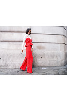 black cat eye Missguided sunglasses - red wide leg Missguided pants
