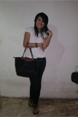 black beanie hat - black longchamp bag - white v-neck Hanes t-shirt - dark brown