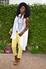 Yellow-pegged-jeans-white-asymmetical-shirt-bronze-leopard-pumps