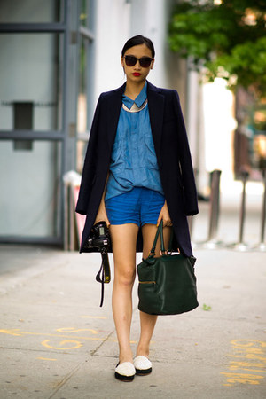 blue shirt - black coat - green bag - blue shorts - yellow necklace
