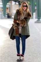 dark green puffy fur unknown brand coat