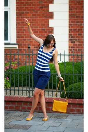 yellow bag - navy shorts - yellow watch - navy top - yellow flats