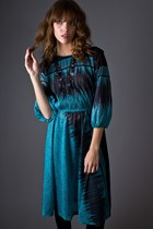 Turquoise-blue-pleated-front-telltale-hearts-vintage-dress
