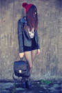 Leather-boots-leather-jacket-jacket-studded-shorts-round-sunglasses
