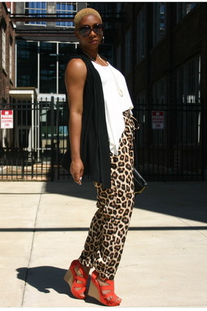 black vest - brown pants - cream top - carrot orange wedges