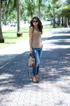 navy ripped Zara jeans - crimson orchard Burberry bag