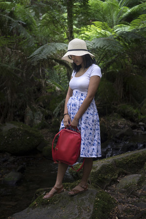 blue skirt - off white straw hat - ruby red faux leather bag