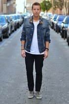 navy denim Balmain jacket - black studded Christian Louboutin loafers