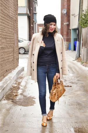 tan camel smythe jacket - dark wash J Brand jeans - black beanie TNA hat