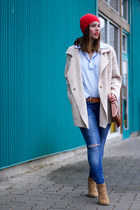 sky blue ripped Gap jeans - beige sweater free people coat - red beanie H&M hat