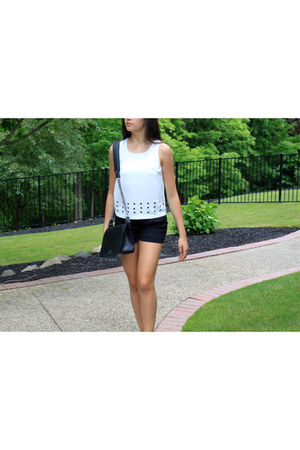 black Chelsea28 shorts - black leather Chanel bag