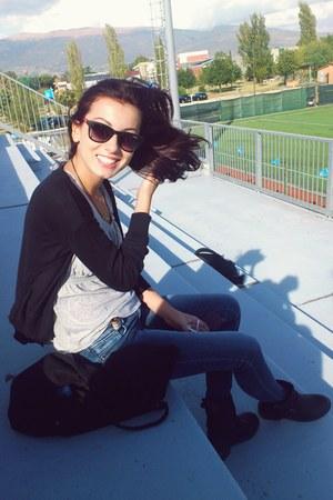 black boots - navy jeans - black Terranova bag - black carrera sunglasses