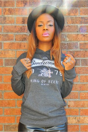 gray hooded Budweiser sweatshirt - black hat - bag - camel faux suede wedges