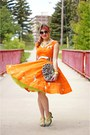 Orange-dress-lime-green-fascinator-hat-silver-clutch-bag-silver-belt