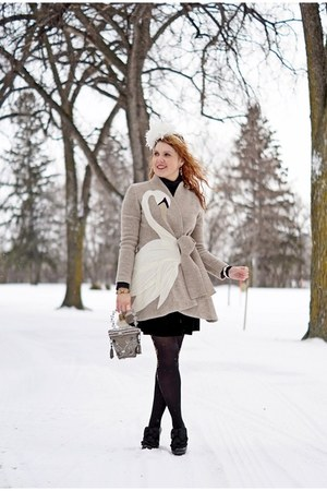 black boots - tan coat - white hat - black tights - heather gray bag