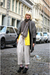 Gray-coat-black-cardigan-beige-pants-yellow-cardigan-black-shoes