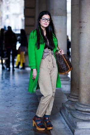 Green-coat-gray-shirt-beige-pants-blue-socks-brown-shoes-brown-purse
