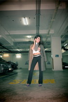 light brown shearling Episode coat - black H&M pants