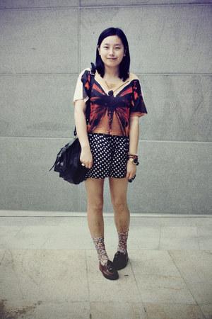 black rubi bag - navy polka dots shorts - light pink floral socks - burnt orange