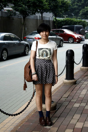 white 2 t-shirt - black shorts - brown purse - blue socks - brown shoes - silver