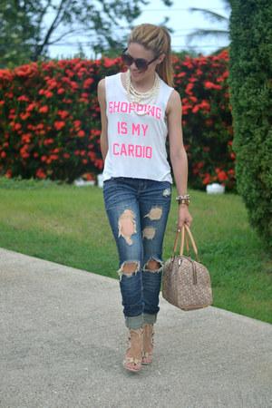 white JC Fits t-shirt - blue distressed 579 jeans - tan DKNY bag