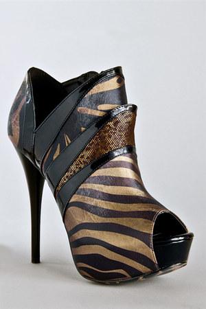 bronze Qupid boots